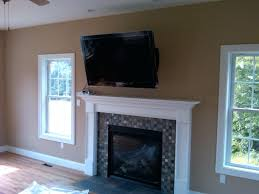 smlf how to hang tv over fireplace without studs ct articulating mount swings left hanging mounting brick