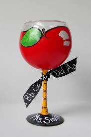 this teacher themed red wine glass has been hand painted like a red apple for teacher stem depicts a ruler and base of glass can be personalized