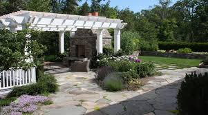 flagstone patio designs. design studio ] a flagstone patio can include flower beds or be installed around the existing trees [ designs
