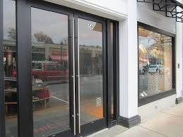 luxurious front door design with dark wooden finish and long vertical door bar handles and large clear screen