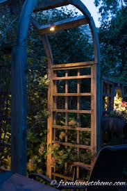 landscaping lighting ideas. Perfect Lighting Subtle Lights Hanging From An Arbor And Landscaping Lighting Ideas