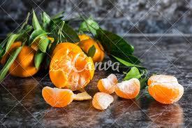 Mandarin Tangerines Orange Tangerines With Green Leaves On Dark Background