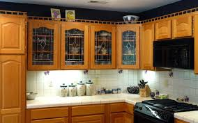 black kitchen cabinets with glass inserts photo 9