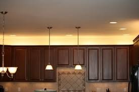 cabinet top lighting. over the cabinet lighting in a kitchen top e