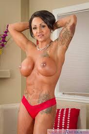 Tattooed Woman Got Her Perky Nipples Pierced photos Ashton Blake.