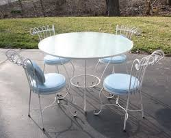 white wrought iron garden furniture. Unique White Fascinating White Wrought Iron Patio Furniture Sets With Round Table And  Chairs Light Blue Cushions Intended Garden T