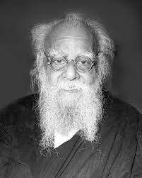 Why this TN Man garlanded Periyar poster with slippers & throw Cow dung on it?