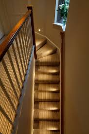 staircase lighting. small led lights lighting the staircase in a beautiful old property l