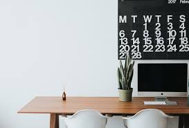 minimalist office. A Minimalist Shot Of Clean Office Desk With Two White Chairs And An Apple All D