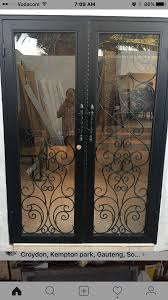 you dont need a ugly iron grill security gate on your front door anymore you can have an all in one steel and glass wrought iron front door