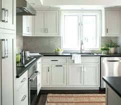 matte black hanging pendant fancy white kitchen cabinet countertop flat granite countertops