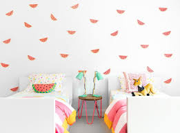 pink and yellow kids room with watermelon wall decals