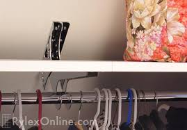 hang a closet rod on slanted wall