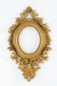 oval vintage gold ornate frame stock photo