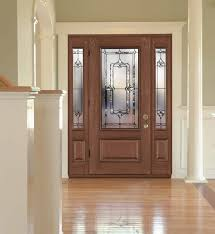 view from inside a home of a modern front door with custom glass inserts