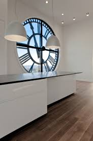 unique large decorative kitchen wall clocks under small ceiling lights and two pendant lamps above