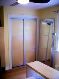 i cut the metal frame of the doors down to fit in the existing closet opening in our bedroom and then cut the plywood panels to fit the frame and applied