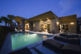 home swimming pools at night. Lit Swimming Pool And House Exterior At Night Home Pools H
