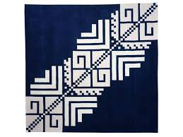 handmade square wool rug with geometric shapes serene by dare to rug