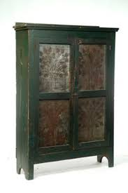 tin furniture. large size with two doors replaced tin panels and old green paint have tree designs furniture s