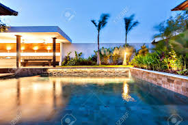 home swimming pools at night. Modern Swimming Pool Illuminates With Lights In A Fancy Hotel Or House At Night Stock Photo Home Pools