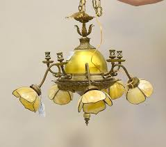 lot 40 gilt metal chandelier with 3 slag glass tulip shape shades with center aurene