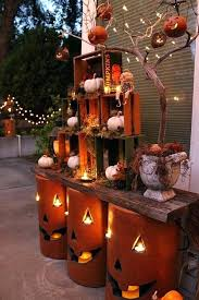 outdoor light up pumpkins simple fall decorating idea nested crates and pottery pumpkins on two weathered