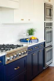 gas stove top cabinet. The Space Stays Light And Bright Due To White Counters, Cabinets Backsplash. A Gas Stove Plus Three Ovens Top Cabinet T