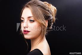 beauty model with professional stylish perfect makeup and a coiffure made by stylists in a beauty