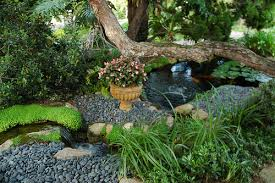 little miniature waterfall and stones flower pot koi pond lily pads trees