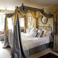 gray canopy bed curtain with fl pattern wallpaper yellow color combination also round wall mirror above platform frame and corner white nightstand full