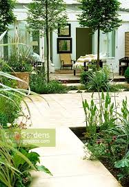 from this pale green furnished garden apartment sliding doors open onto an interior courtyard