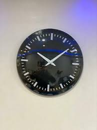 london clock company square glass wall