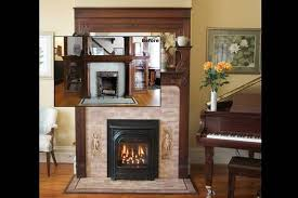 by upgrading an old wood burning fireplace with a new propane or wood insert