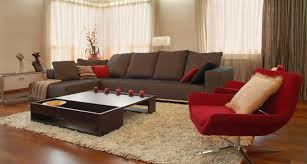brown living room rugs. Brown And Red Living Room Decor With Couch An Chair On Beige Rugs Ideas