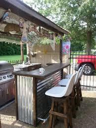 outdoor tiki bar with homemade bar