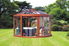 gazebo glass. this enclosed hot tub with a glass paneled gazebo is the perfect space for looking out