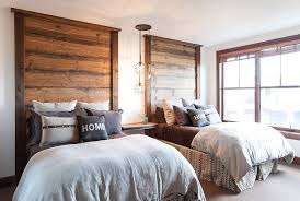 view in gallery headboards and light fixture steal the show in this bedroom design high camp home