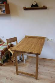 this murphy table in solid oak is a perfect solution if there is not much space in your kitchen living room or any other room if it is time to drink your