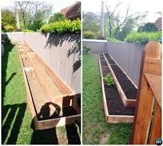 diy raised garden bed along fence