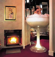 Tall Champagne Glass Whirlpool Bath for Two at Caesars Pocono Resorts.