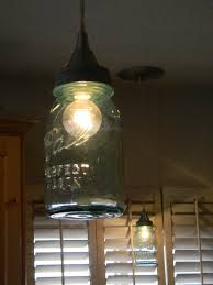 Make canning jars into lights in a few easy steps. Step by step instructions  will give you directions on how to make hanging Ball jar lights.