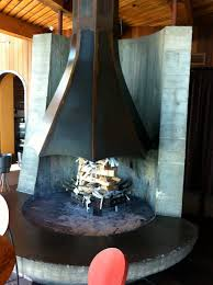 interior black cone metal open hanging metal fireplace with curved black hearth amazing metal