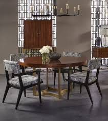 dining room ashton dining room by maison 55 this round dining table from the ashton collection incorporates a br finish contrasted by a wooden table