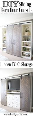 the barn door console do you not like it for your tv to be sitting out in the open of your living room i totally get it i m the exact same way