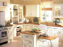 white cabinets with wood countertops small kitchen idea of the day white cabinets and tile white