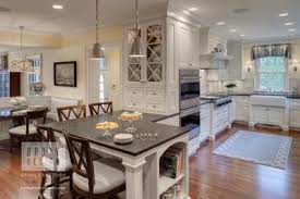 the ambient light layer is usually provided by overhead lighting and adds general light for most activities ambient kitchen lighting