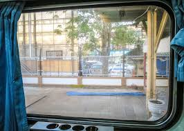 the surat thani to bangkok train ride window view
