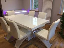 breeze glass topped extendable dining table