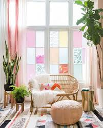 pastel color furniture. living room w lovely pastel colored glass windows lots of plants patterned rug color furniture